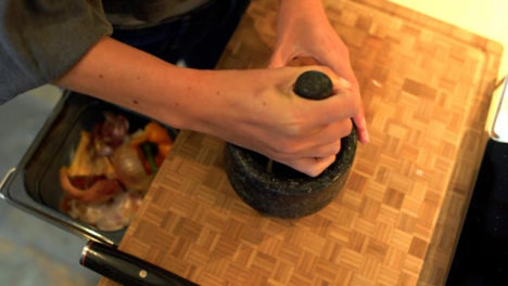 Close-Up-of-Female-Hands-Grinding-Onion-