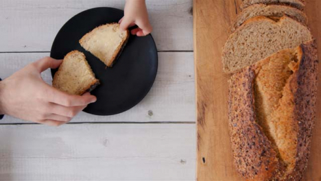 Top-View-Child-and-Dad-Picking-Up-Slice-of-Bread
