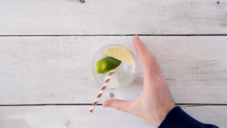Top-view-Hand-Putting-Straw-in-a-Lemonade-Drink
