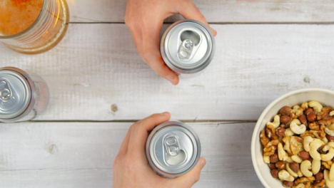 Top-View-Opening-Beer-Cans-and-Toasting-Drinks