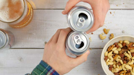 Top-View-Picking-Up-Beer-Cans-and-Toasting-Drinks