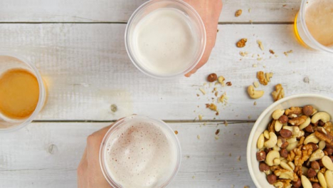 Top-View-Male-Hands-Pick-Up-Cups-of-Beer-and-Cheers-Drinks