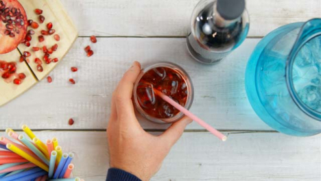 Top-View-Male-Hands-Stirring-Summer-Drink-and-Taking-Away