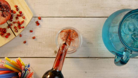 Top-View-Male-Hands-Pouring-Ice-and-Liquor-into-Small-Glass