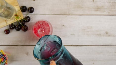 Top-View-Male-Hand-Pouring-Fruity-Summer-Drink-with-Copy-Space