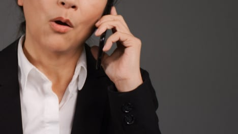 Middle-Aged-Businesswoman-Having-Heated-Phone-Call