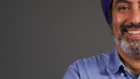 Middle-Aged-Man-In-Turban-Smiling-with-Copy-Space