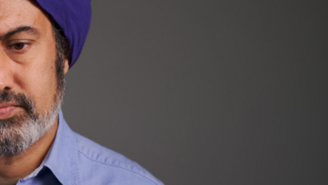 Middle-Aged-Man-In-Turban-Visibly-Concerned-with-Copy-Space