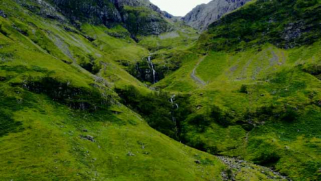 Aerial-Drone-Shot-of-Downhill-Stream-in-glen-coe