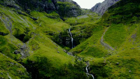 Aerial-Drone-Shot-of-a-Downhill-Stream-in-Glen-Coe