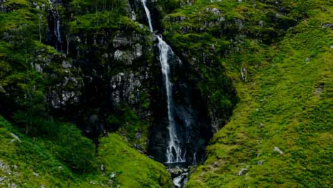 Aerial-Drone-Shot-of-Waterfall-in-Glen-Coe