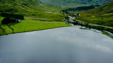 Sweeping-Aerial-Drone-Shot-of-Loch-Achtriochtan-in-Glen-Coe