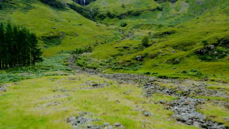 Aerial-Drone-Shot-of-Downhill-Stream-in-Glen-Coe-Scotland