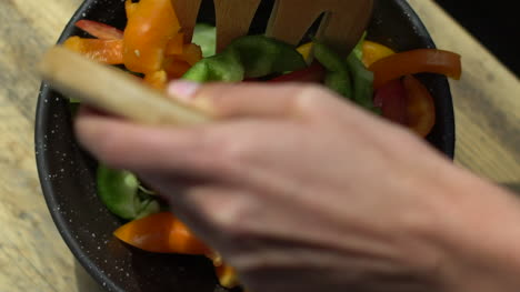 Close-Up-of-Female-Hands-Mixing-Salad-Bowl-Contents