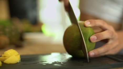 Close-Up-of-Female-Hands-Cutting-a-Mango-