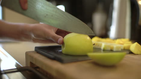 Close-Up-of-Female-Hands-Slicing-a-Green-Apple-