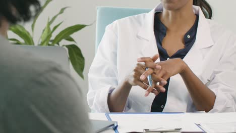 Mid-Section-Young-Doctor-Discussing-Results-With-Patient