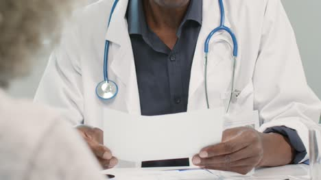 Mid-Section-Male-Doctor-Discussing-Results-With-Patient