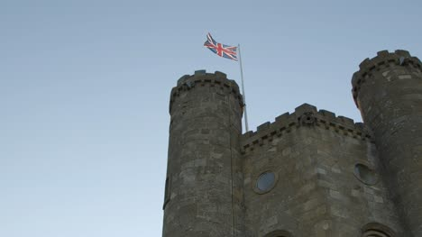 Great-Britain-Flag-on-Tower-with-Blue-Sky