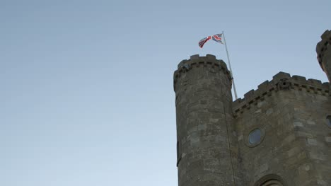British-Flag-on-Tower-with-Blue-Sky