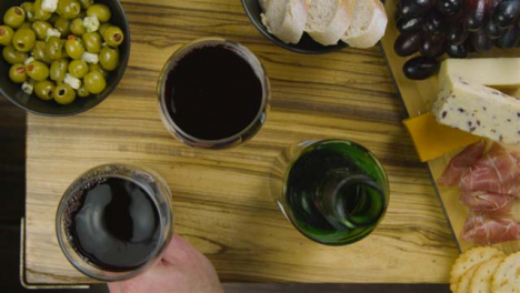 Man-Taking-Away-Glass-of-Red-Wine-and-Placing-Back-Down-04