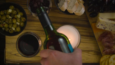 Man-Refilling-an-Empty-Wine-Glass-with-Red-Wine-