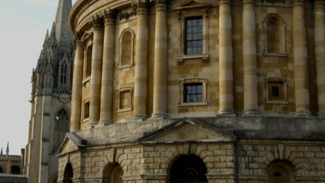 Tilting-Shot-of-Radcliffe-Camera-Building-and-Bicycles-Locked-to-Railing