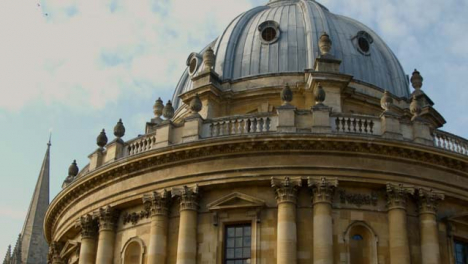Tilting-Shot-of-the-Radcliffe-Camera-Building-and-Bicycles-Locked-to-Railing