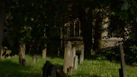 Tracking-Shot-of-Saint-Mary-Magdalen-Church-Graveyard-