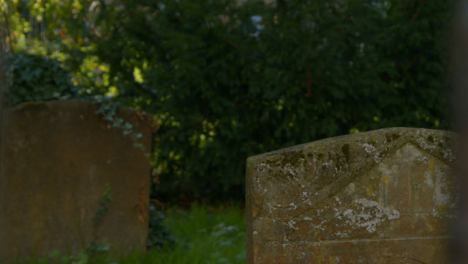 Tracking-Shot-of-Grave-Headstones-In-Oxford-Graveyard-