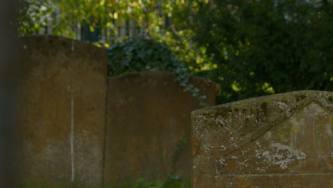 Pull-Focus-Shot-of-Tombstones-In-Oxford-Graveyard-
