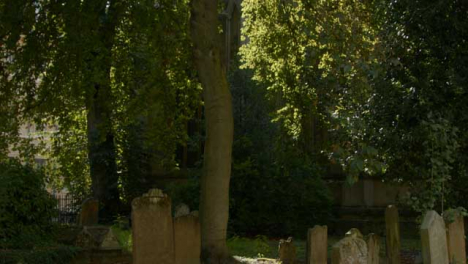 Tilting-Shot-of-Saint-Mary-Magdalen-Church-Graveyard-In-Oxford