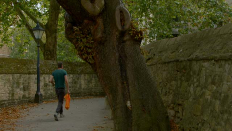 Tracking-Shot-of-Man-Walking-Down-Scenic-Alleyway-In-Oxford