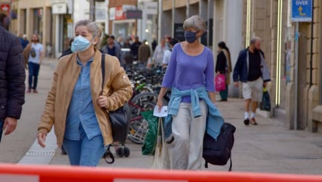 Long-Shot-of-People-In-Face-Masks-Walking-Down-Busy-Oxford-Street
