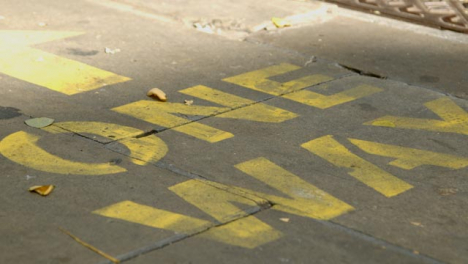 Close-Up-of-One-Way-Pavement-Marking-In-Oxford-England