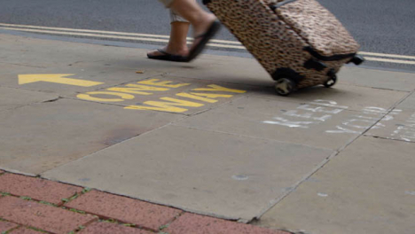 Close-Up-Shot-of-Feet-Walking-Over-One-Way-Pavement-Marking-In-Oxford-England
