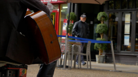 Medium-Shot-from-Behind-Busker-On-Cornmarket-Street-In-Oxford-