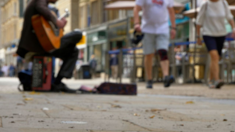 Low-Angle-Shot-of-Busker-On-Busy-Street-In-Oxford-01