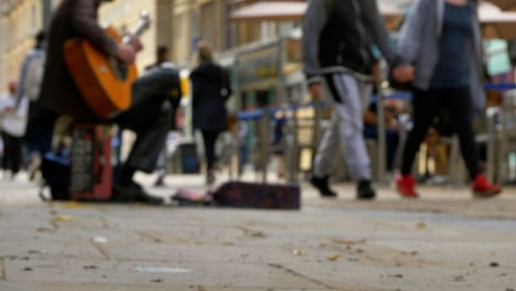 Low-Angle-Shot-of-Busker-On-Busy-Street-In-Oxford-02