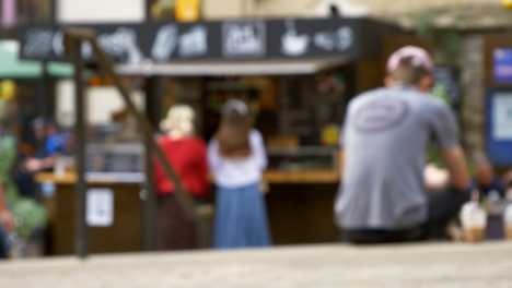 Defocused-Shot-of-Young-Girls-at-Outdoor-Coffee-Stall-In-Oxford-England-01