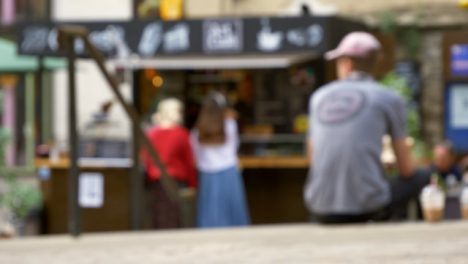 Defocused-Shot-of-Young-Girls-at-Outdoor-Coffee-Stall-In-Oxford-England-02