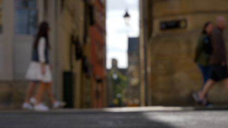 Defocused-Shot-of-Pedestrians-and-Traffic-On-High-Street-In-Oxford-England-02