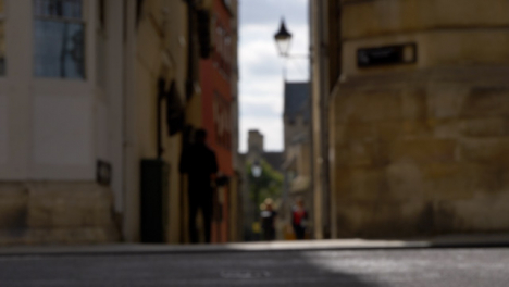 Defocused-Shot-of-Pedestrians-and-Traffic-On-High-Street-In-Oxford-01