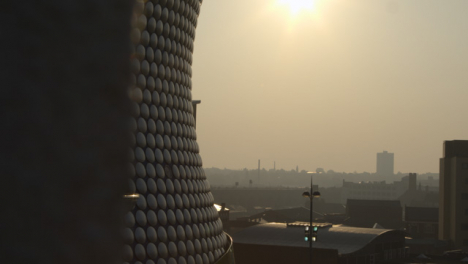 Pan-Reveal-of-Cityscape-with-Selfridges-Building-in-Morning