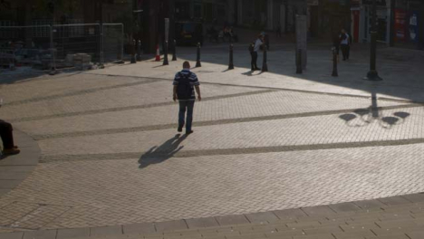 Sliding-Wide-Shot-of-People-In-Birminghams-Victoria-Square