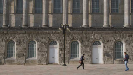 Wide-Shot-of-Two-People-Walking-Through-Victoria-Square