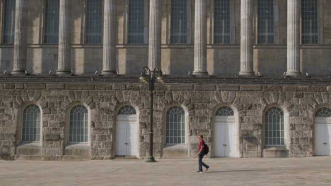 Wide-Shot-of-Person-Walking-Through-Birminghams-Victoria-Square