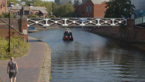 Panning-Shot-of-Canal-Boat-In-Birmingham-Canal-
