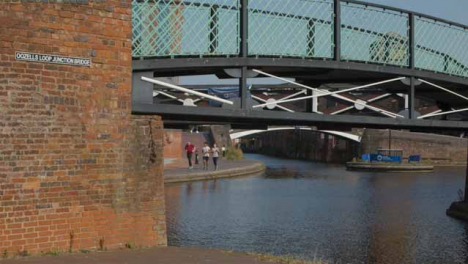 Panning-Shot-of-Runners-Alongside-a-Canal-In-Birmingham