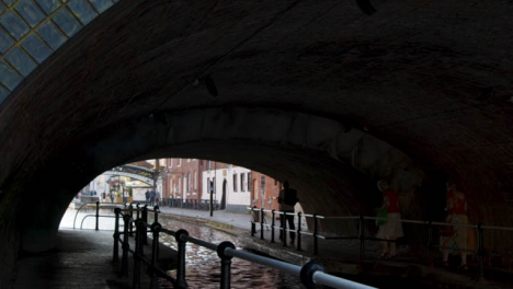 Tracking-Shot-of-People-Going-Through-a-Canalside-Tunnel-